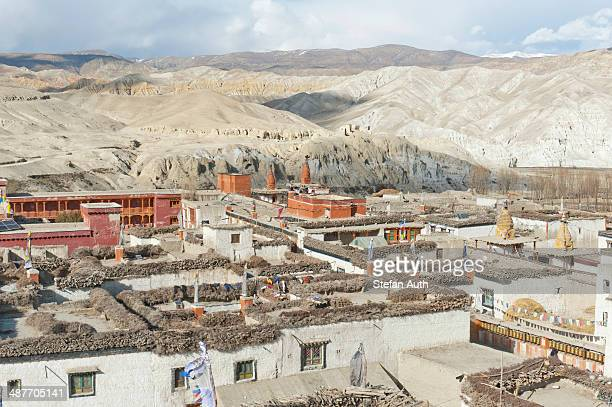 wide landscape with hills, view over the walled city north to tibet, lo manthang, upper mustang, nepal, asia - lo manthang stock pictures, royalty-free photos & images
