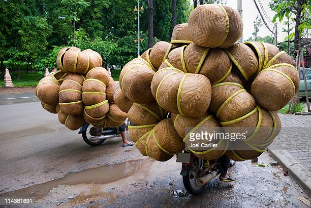 wide load on motorcycles in phnom penh, cambodia - cambodian culture stock photos and pictures