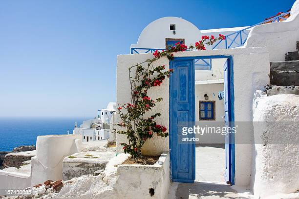wide open blue door and bougainvillea - santorini stock pictures, royalty-free photos & images