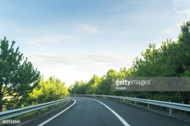 wide open highway with asphalt road in Autumn under blue sky