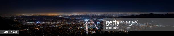 wide panoramic view of los angeles at night - san fernando california stock photos and pictures