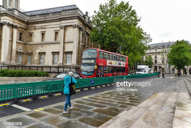 Wide pavements are installed in Charing Cross road to create street space for the expected increase in people walking to work and to aid them in...