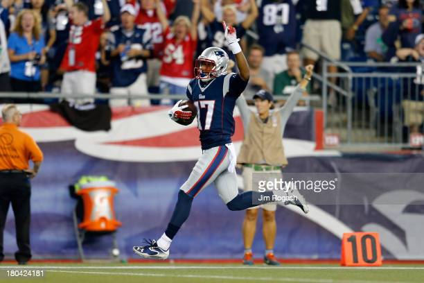 Wide receiver Aaron Dobson of the New England Patriots celebrates as he runs to score on a 39yard catch in the first quarter against the New York...