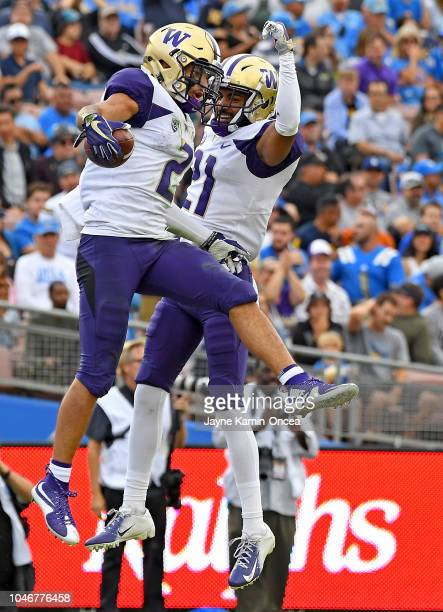 Wide receiver Aaron Fuller celebrates with wide receiver Quinten Pounds of the Washington Huskies after a touch down in the first quarter of the game...