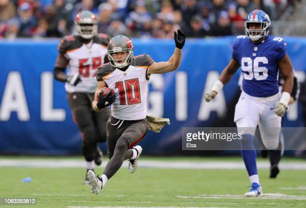 Wide receiver Adam Humphries of the Tampa Bay Buccaneers carries the ball against linebacker Kareem Martin of the New York Giants during the third...