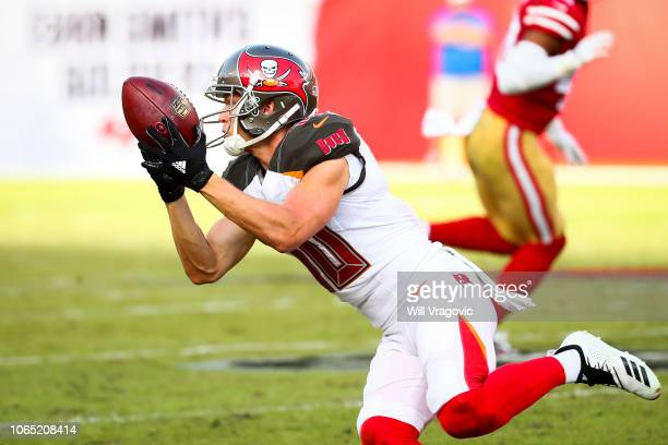 Wide receiver Adam Humphries of the Tampa Bay Buccaneers completes a pass from quarterback Jameis Winston for a first down in the fourth quarter of...