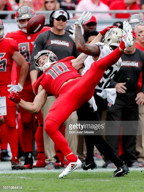 Wide Receiver Adam Humphries of the Tampa Bay Buccaneers is defended by Cornerback PJ Williams of the New Orleans Saints during the game at Raymond...