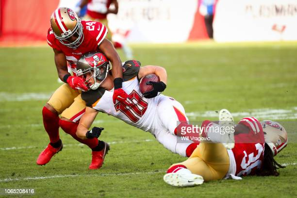 Wide receiver Adam Humphries of the Tampa Bay Buccaneers is dragged down by defensive back K'Waun Williams of the San Francisco 49ers after a first...