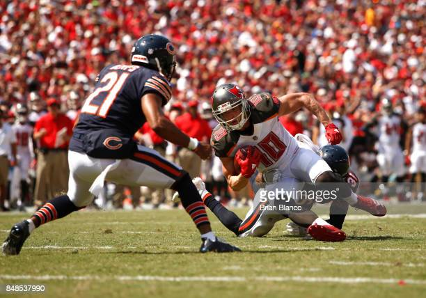 Wide receiver Adam Humphries of the Tampa Bay Buccaneers is stopped by defensive back Marcus Cooper of the Chicago Bears and strong safety Quintin...