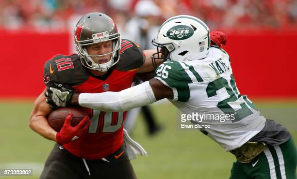 Wide receiver Adam Humphries of the Tampa Bay Buccaneers is tackled by free safety Marcus Maye of the New York Jets after hauling in a pass from...