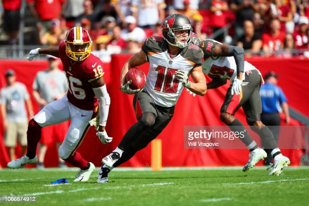 Wide receiver Adam Humphries of the Tampa Bay Buccaneers returns a punt to the 15 yard line in the first quarter of the game between the Tampa Bay...