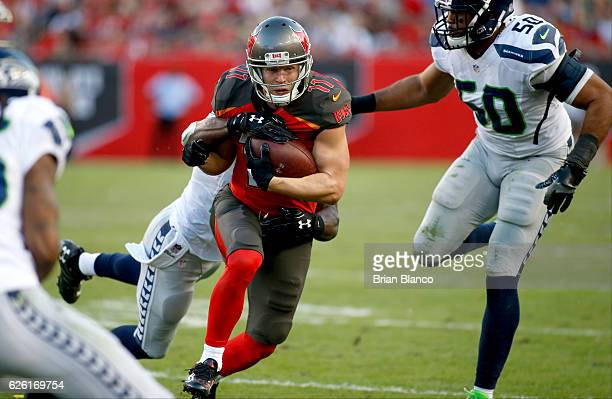 Wide receiver Adam Humphries of the Tampa Bay Buccaneers runs for several yards against strong safety Kam Chancellor of the Seattle Seahawks and...