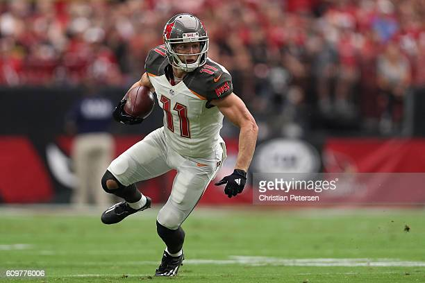 Wide receiver Adam Humphries of the Tampa Bay Buccaneers runs with the football after a reception against the Arizona Cardinals during the NFL game...