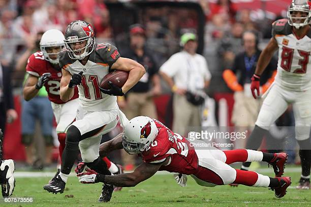 Wide receiver Adam Humphries of the Tampa Bay Buccaneers slips by outside linebacker Deone Bucannon of the Arizona Cardinals during the third quarter...