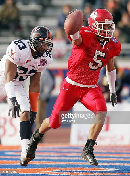 Wide receiver Adam Jennings of Fresno State celebrates after catching a pass for a touchdown in front of Tony Franklin of Virginia in the first...