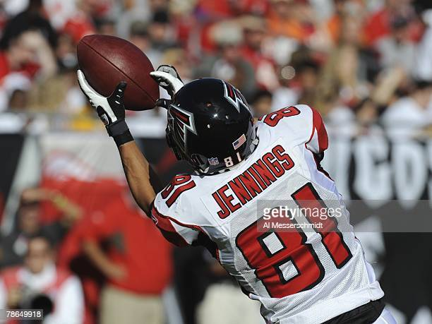Wide receiver Adam Jennings of the Atlanta Falcons stretches for a kick against the Tampa Bay Buccaneers at the Raymond James Stadium on December 16...