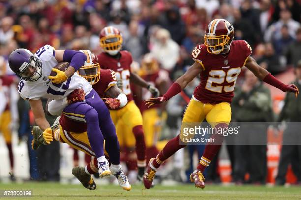 Wide receiver Adam Thielen is tackled by inside linebacker Zach Brown of the Washington Redskins during the second quarter of the Minnesota Vikings...