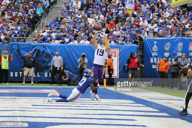 Wide Receiver Adam Thielen of the Minnesota Vikings catches a third Quarter Touchdown against Cornerback Deandre Baker of the New York Giants during...