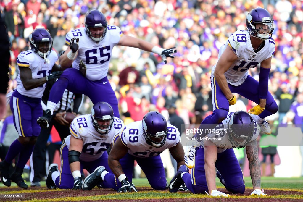 Wide receiver Adam Thielen #19 of the Minnesota Vikings celebrates with teammates after scoring a touchdown during the second quarter against the Washington Redskins at FedExField on November 12, 2017 in Landover, Maryland.