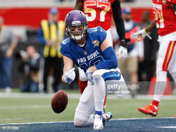 Wide receiver Adam Thielen of the Minnesota Vikings from the NFC Team flips the ball after scoring a touchdown during the NFL Pro Bowl Game at...