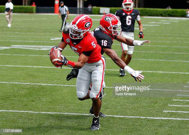 Wide receiver Adonai Mitchell of the Georgia Bulldogs makes a reception for a touchdown during the first half of the G-Day spring game at Sanford...
