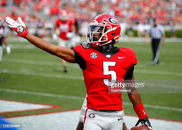 Wide receiver Adonai Mitchell of the Georgia Bulldogs reacts after a touchdown during the first half of the G-Day spring game at Sanford Stadium on...