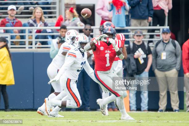 Wide receiver AJ Brown of the Mississippi Rebels looks to catch a pass in front of linebacker Richard Jibunor of the Auburn Tigers during the forth...