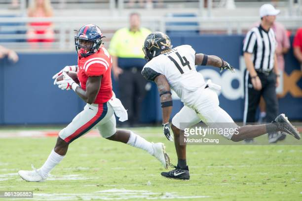 Wide receiver AJ Brown of the Mississippi Rebels looks to maneuver the ball by safety Ryan White of the Vanderbilt Commodores at VaughtHemingway...