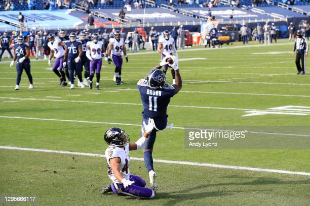 Wide receiver A.J. Brown of the Tennessee Titans catches a 10-yard touchdown pass against cornerback Marlon Humphrey of the Baltimore Ravens during...