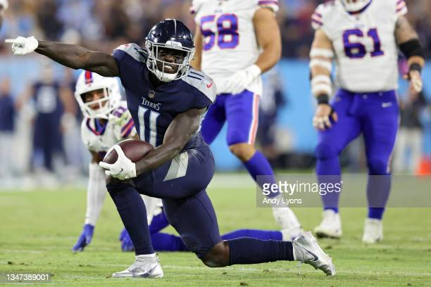 Wide receiver A.J. Brown of the Tennessee Titans celebrates a first down against the Buffalo Bills during the third quarter at Nissan Stadium on...
