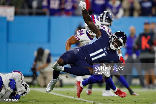 Wide receiver A.J. Brown of the Tennessee Titans is tackled against the Buffalo Bills during the third quarter at Nissan Stadium on October 18, 2021...