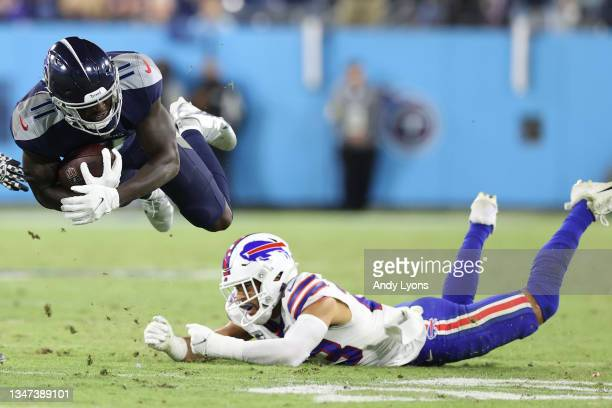 Wide receiver A.J. Brown of the Tennessee Titans is tackled by safety Micah Hyde of the Buffalo Bills during the third quarter at Nissan Stadium on...