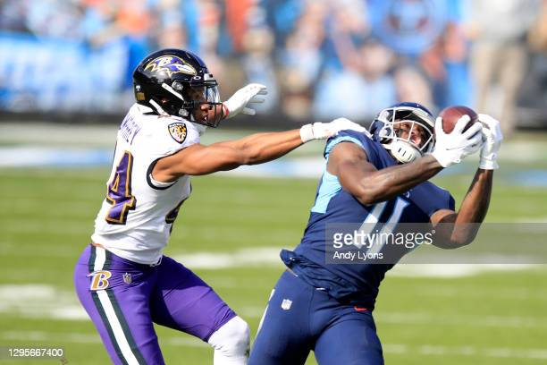 Wide receiver A.J. Brown of the Tennessee Titans makes a catch against cornerback Marlon Humphrey of the Baltimore Ravens during the first quarter of...