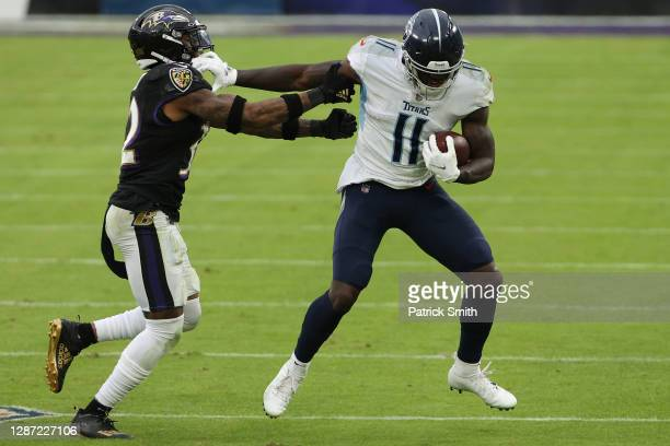 Wide receiver A.J. Brown of the Tennessee Titans rushes against the Baltimore Ravens during the second half at M&T Bank Stadium on November 22, 2020...