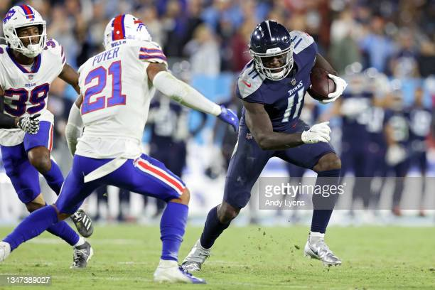 Wide receiver A.J. Brown of the Tennessee Titans rushes past free safety Jordan Poyer of the Buffalo Bills during the third quarter at Nissan Stadium...