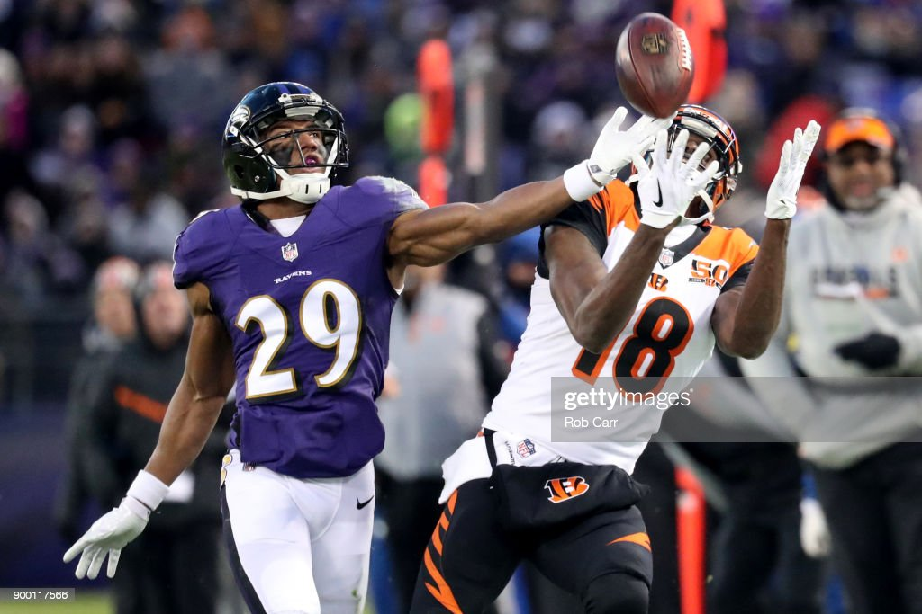 Wide Receiver A.J. Green #18 of the Cincinnati Bengals catches a pass while defended by defensive back Marlon Humphrey #29 of the Baltimore Ravens in the first quarter at M&T Bank Stadium on December 31, 2017 in Baltimore, Maryland.