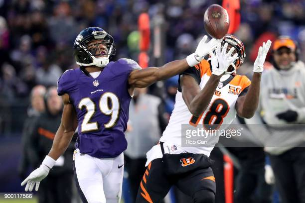Wide Receiver AJ Green of the Cincinnati Bengals catches a pass while defended by defensive back Marlon Humphrey of the Baltimore Ravens in the first...