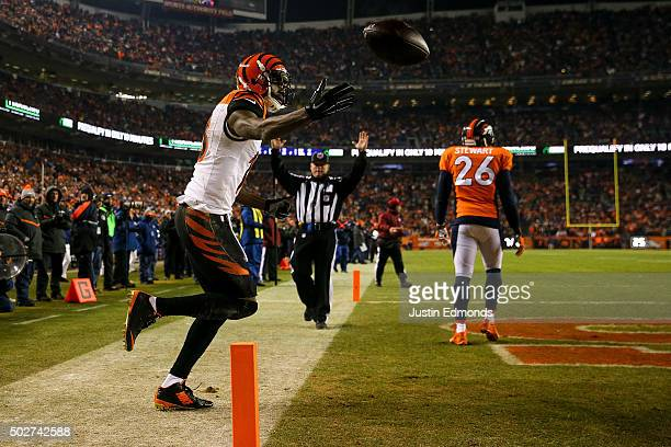Wide receiver AJ Green of the Cincinnati Bengals celebrates after catching a 5yard first quarter touchdown against the Denver Broncos at Sports...