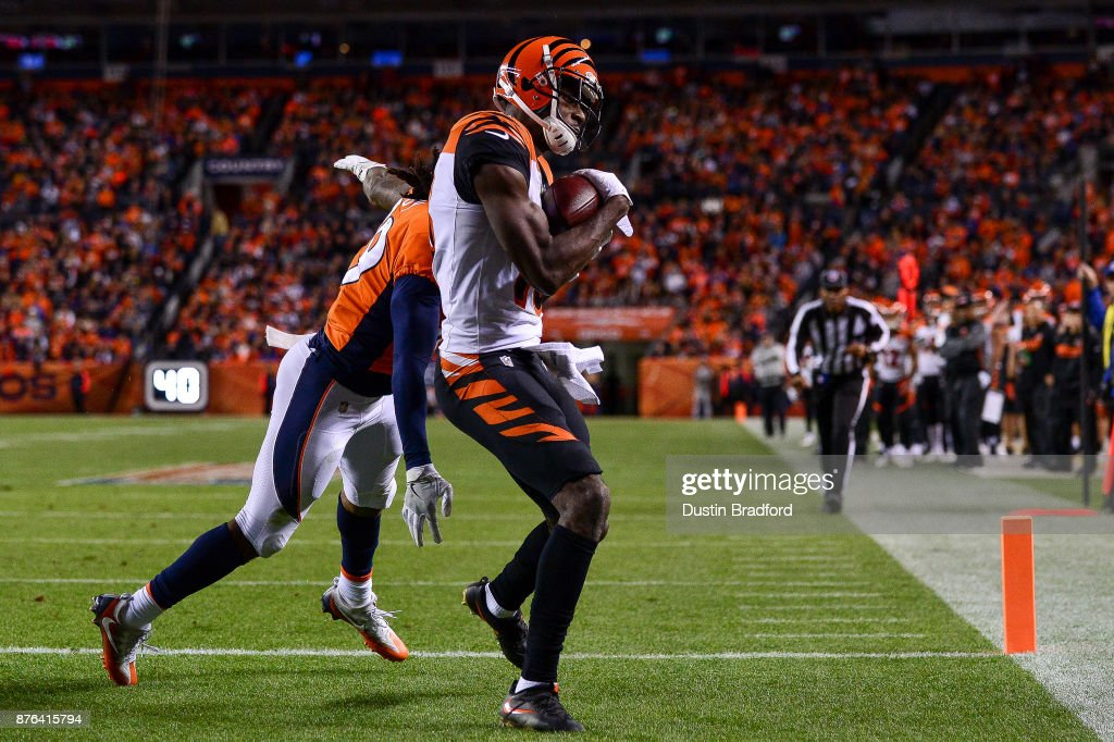 Wide receiver A.J. Green #18 of the Cincinnati Bengals has a fourth quarters touchdown catch under coverage by free safety Bradley Roby #29 of the Denver Broncos at Sports Authority Field at Mile High on November 19, 2017 in Denver, Colorado.