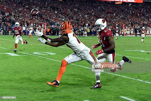 Wide receiver AJ Green of the Cincinnati Bengals hauls in a pass while being defended by cornerback Patrick Peterson of the Arizona Cardinals during...