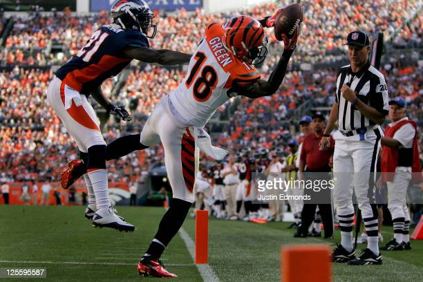 Wide receiver A.J. Green of the Cincinnati Bengals makes a catch for a touchdown as Cornerback Andre' Goodman of the Denver Broncos defends during...