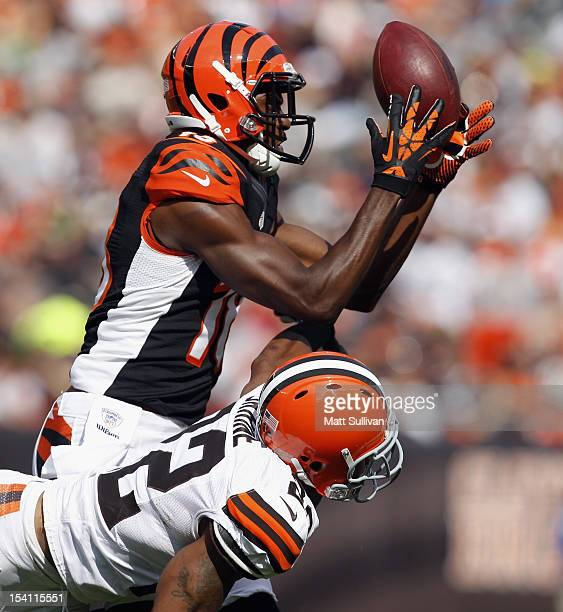 Wide receiver AJ Green of the Cincinnati Bengals makes a catch over defensive back Buster Skrine of the Cleveland Browns at Cleveland Browns Stadium...