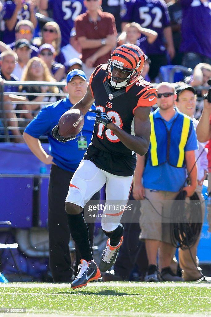 Wide receiver A.J. Green #18 of the Cincinnati Bengals rushes for a touchdown after catching a pass during the second half of an NFL football game against the Baltimore Ravens at M&T Bank Stadium on September 7, 2014 in Baltimore, Maryland.