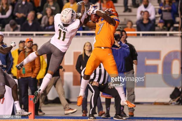Wide receiver AJ Richardson of the Boise State Broncos goes up and takes away a touchdown pass from safety Jordan Fogal of the Colorado State Rams...