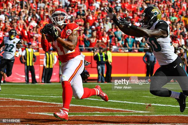 Wide receiver Albert Wilson of the Kansas City Chiefs brings in a touchdown reception over outside linebacker Telvin Smith of the Jacksonville...