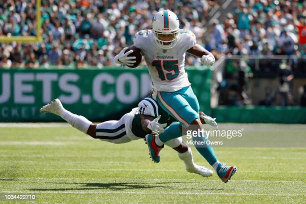 Wide receiver Albert Wilson of the Miami Dolphins carries the ball in for a touchdown against defensive back Buster Skrine of the New York Jets...