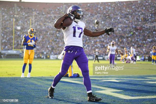 Wide receiver Aldrick Robinson of the Minnesota Vikings catches to score a touchdown and take a 70 lead against the Los Angeles Rams in the first...