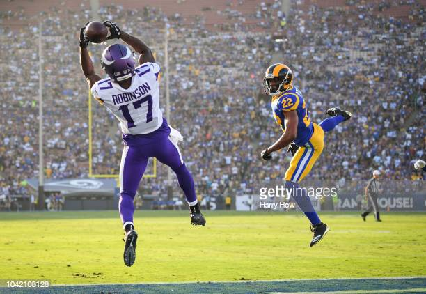 Wide receiver Aldrick Robinson of the Minnesota Vikings makes a catch in front of cornerback Marcus Peters of the Los Angeles Rams to score a...