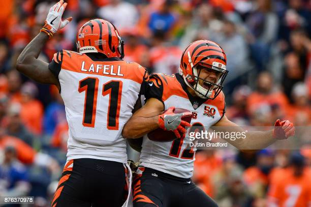 Wide receiver Alex Erickson of the Cincinnati Bengals celebrates with Brandon LaFell after 29 yard second quarter touchdown reception against the...