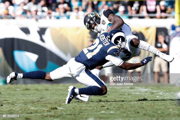 Wide Receiver Allen Hurns of the Jacksonville Jaguars is tackled by Cornerback Kayvon Webster of the Los Angeles Rams after a catch during the game...
